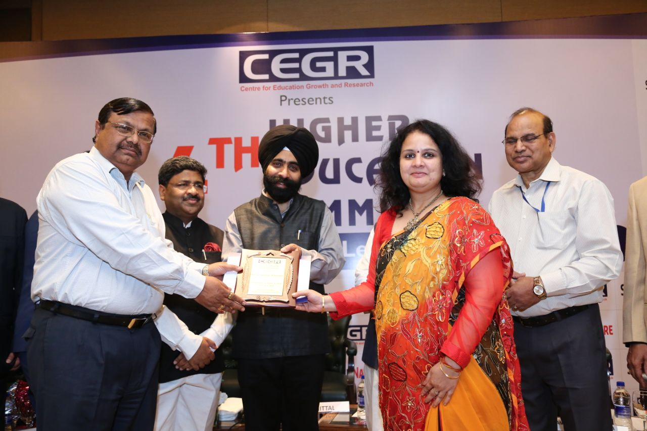 Dr. S.K. Mahapatra , Director Jaipuria School of Business  Receiving Award for Outstanding Academic Leader  at 4th Education Summit of CEGR from Dr MS Manna Director AICTE in the presence of Dr Punia, Member Secretary AICTE